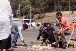 """""""I started living with Abraham a few months back. He's visually impaired and used to make a living begging on the streets. I took him in to live with me and taught him how I did my business so he also started his own. Until he sets up well, I do not ask him to cover rent costs at home."""" """"ከአብርሃም ጋር መኖር ከጀመርኩ ጥቂት ወራት ተቆጥረዋል፡፡ እሱም በልመና የሚተዳደር አይነስውር ነበር፡፡ ልመናን ትቶ እኔ የምሰራውን አይነት ስራ እየሰራ ከኔ ጋር እንዲኖር በማሰብ ወደ እኔ ቤት አስገባሁት፡፡ በራሱ በደንብ እስኪደራጅ ድረስ የቤት ኪራይ አልጠይቀውም፡፡"""""""