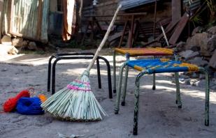 """I also make mops, brooms and repair electrical fixtures."" ""በተጨማሪም መጥረጊያና መወልወያ እሰራለሁ፡፡ የኤሌክትሪክ እቃዎችንም እጠግናለሁ፡፡"""