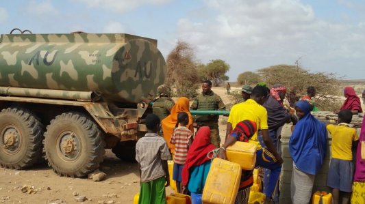 African Union (AMISOM) troops in Kismaayo on March 11th, 2017 sharing water and food supplies with residents hit by the severe drought.