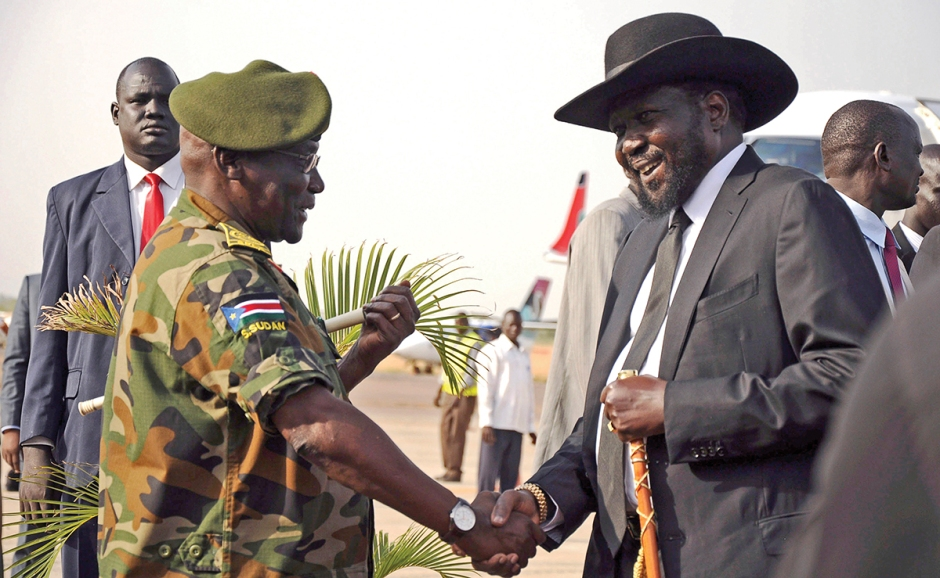 South Sudan's President Salva Kiir is received by SPLA Chief of General Staff Awan at the airport in Juba
